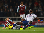 Picture by David Horn/Focus Images Ltd +44 7545 970036<br /> 23/11/2013<br /> Mark Noble of West Ham United and Ramires of Chelsea during the Barclays Premier League match at the Boleyn Ground, London.