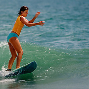 Erin Whittle surfs a wave at the East Coast Wahine Contest in Wrightsville Beach, NC