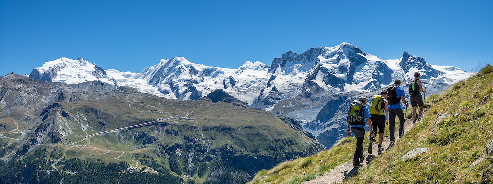 Seen from Höhbalmen Höhenweg trail, left to right are the peaks of: Monte Rosa massif / Dufourspitze (4634 m / 15,203 ft, second-highest mountain of the Alps and highest of Switzerland), Liskamm, Castor, Pollux, and Breithorn in the Pennine/Valais Alps, Europe. From Zermatt, hike the scenic Höhbalmen Höhenweg loop via Bergrestaurant Edelweiss, Trift Hut and Zmutt, in the Pennine Alps, Switzerland, Europe. With delightful views of many peaks and glaciers, this strenuous walk went up and down 1200 meters over 21.6 km (13.4 miles). This image was stitched from multiple overlapping photos.