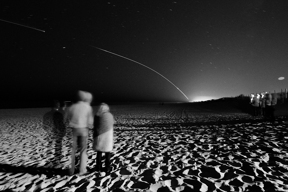 A Minotaur V rocket carrying the LADEE spacecraft on its way to study the Moon's tenuous atmosphere, is captured jettisoning it's second stage seen from ship bottom, New Jersey, on September 6 2013.