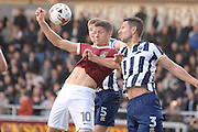 Northampton Town striker Alex Revell (10) battles Millwall defender Joe Martin (3)  during the EFL Sky Bet League 1 match between Northampton Town and Millwall at Sixfields Stadium, Northampton, England on 15 October 2016. Photo by Dennis Goodwin.