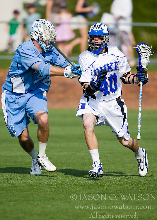 Duke attackman Matt Danowski (40) is guarded by North Carolina defenseman Jack Ryan (32).  The #2 ranked Duke Blue Devils defeated the #12 ranked North Carolina Tar Heels 17-6 in the semi finals of the Men's 2008 Atlantic Coast Conference tournament at the University of Virginia's Klockner Stadium in Charlottesville, VA on April 25, 2008.