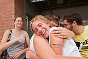 31 JULY 2010 - PHOENIX, AZ: LEAH CARNINE is greeted by supporters upon her release from the 4th Ave Jail in Phoenix Saturday. She was one of the last protesters arrested Friday night for blockading one of the Maricopa County Sheriff's buildings Friday during a crime sweep. She was held in the jail for 20 hours. The last of the people arrested in Phoenix for protesting against Arizona's tough anti-illegal immigration law, SB 1070, were released from the 4th Ave Jail in Phoenix, AZ, Saturday morning. More than 60 people have been arrested for various charges related to peaceful protests that have been held across the city during marches and demonstrations against SB 1070 and Maricopa Sheriff Joe Arpaio's controversial crime sweeps which take place in heavily Hispanic neighborhoods.   Photo by Jack Kurtz