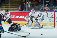 KELOWNA, CANADA - OCTOBER 20:  Conner Bruggen-Cate #20 of the Kelowna Rockets falls to the ice as Brad Ginnell #27 passes the puck away from the net of Cole Kehler #31 of the Portland Winterhawks during second period on October 20, 2017 at Prospera Place in Kelowna, British Columbia, Canada.  (Photo by Marissa Baecker/Shoot the Breeze)  *** Local Caption ***