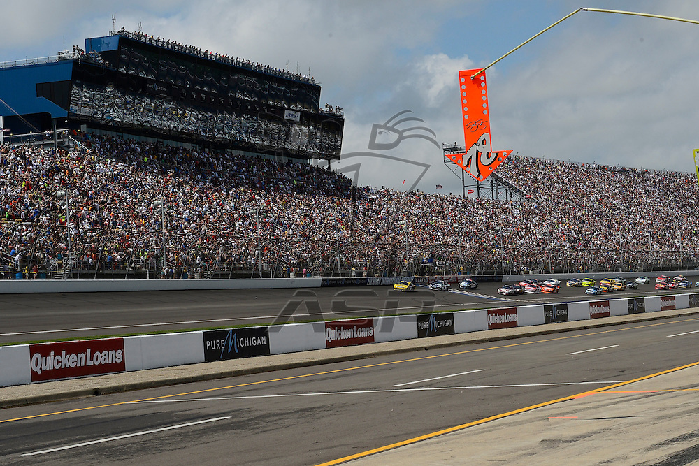 Brooklyn, MI - JUN 17, 2012: The green flag waves during race action for the Quicken Loans 400 race at the Michigan International Speedway in Brooklyn, MI.