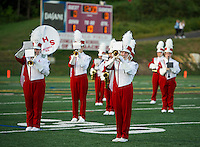 The Sachems Marching Band welcomes the crowd at Jim Fitzgerald Field for the home opener Friday night under the lights.  (Karen Bobotas/for the Laconia Daily Sun)