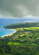 Aerial view of Princeville and Hanalei Beach on the northern coast of Kauai, Hawaii on a cloudy day.