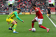 Matheus Pereira (12) of West Bromwich Albion battles for possession with Niclas Eliasson (19) of Bristol City during the EFL Sky Bet Championship match between Bristol City and West Bromwich Albion at Ashton Gate, Bristol, England on 22 February 2020.