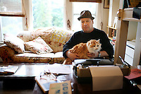 "Writer and poet August Kleinzahler, 60, reviews his work in the living room where he works a typewriter and desk, at his home, in San Francisco, Ca., on Friday, February 6, 2008. Kleinzahler recently published his tenth collection of poetry, ""Sleeping it off in Rapid City"" last year."