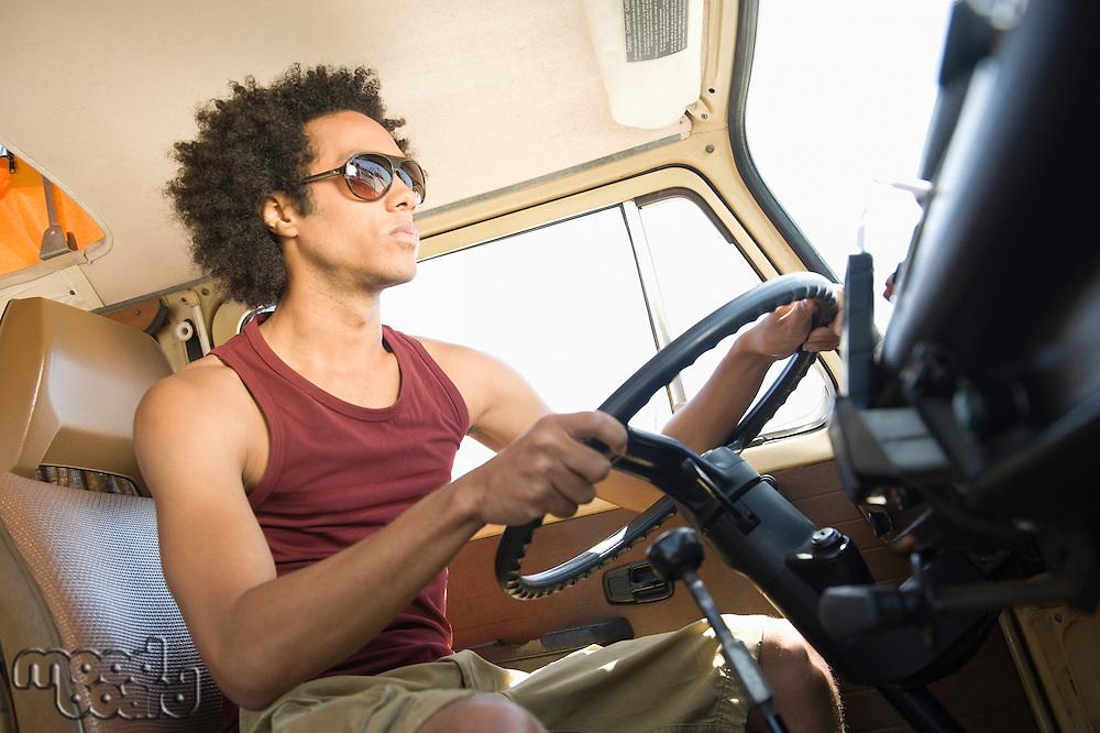 Young man in camper van