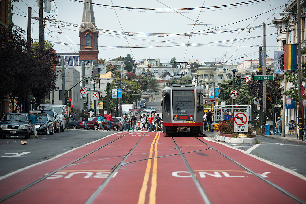 Muni's red carpet which runs along Church Street, from Duboce Avenue to 16th Street, was painted red to clearly identify the center lanes prioritized for public transit and taxi's | July 30, 2013