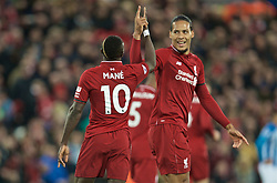 LIVERPOOL, ENGLAND - Friday, April 26, 2019: Liverpool's Sadio Mane (10) celebrates scoring the second goal with team-mate Virgil van Dijk during the FA Premier League match between Liverpool FC and Huddersfield Town AFC at Anfield. (Pic by David Rawcliffe/Propaganda)