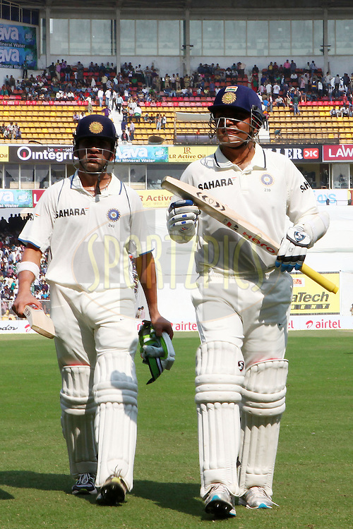 Gautam Gambhir of India and Virender Sehwag of India leave the field for lunch during day one of the 1st Airtel Test Match between India and England held at the Sadar Patel Stadium in Ahmedabad, Gujarat, India on the 15th November 2012...Photo by Ron Gaunt/ BCCI/ SPORTZPICS