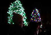A mother holds her child in the Sandy Hook section of Newtown during tree lighting festivities, Saturday, Dec. 2, 2017. (Jessica Hill for the New York Times)