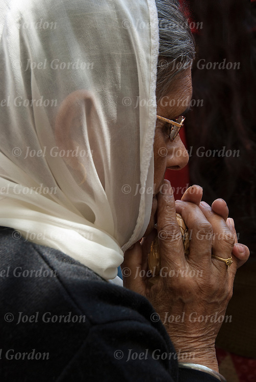 Close up of hands of Sikh-American elderly woman wearing sari or saree, praying before the start of the annual Sikh Day Parade in NYC.