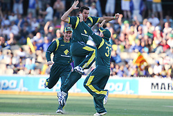© Licensed to London News Pictures. 08/03/2012. Adelaide Oval, Australia. Australian bowler Clint McKay celebrates by jumping in the air after getting the wicket of Dinesh Chandimal LBW for 5 runs during the One Day International cricket match final between Australia Vs Sri Lanka. Photo credit : Asanka Brendon Ratnayake/LNP