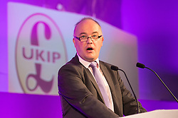 """© Licensed to London News Pictures . 25/09/2015 . Doncaster , UK . ANDREW ALLISON of """" The Freedom Association """" speaks at the 2015 UKIP Party Conference at Doncaster Racecourse . Photo credit : Joel Goodman/LNP"""
