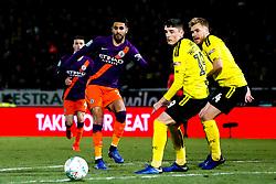 Riyad Mahrez of Manchester City takes on Reece Hutchinson of Burton Albion and Damien McCrory of Burton Albion - Mandatory by-line: Robbie Stephenson/JMP - 23/01/2019 - FOOTBALL - Pirelli Stadium - Burton upon Trent, England - Burton Albion v Manchester City - Carabao Cup