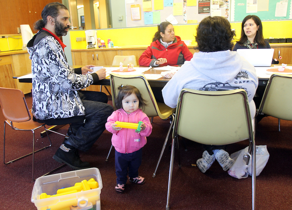 Guadalupe Santiago plays with a toy during a weekly Latino parent-teacher meeting at King Elementary School on Wednesday, March 7, 2012.