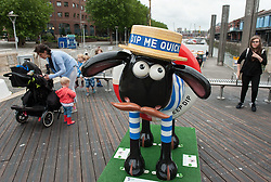© Licensed to London News Pictures. 06/07/2015. Bristol, UK.  SHAUN THE SHEEP, 'Beach Boy' designed by Mike Ogden.  The Shaun in the City trail starts today with 70 5ft tall Shaun the Sheep sculptures originally devised by Aardman Animations with these sculptures decorated by various artists.  The Shaun trail happened in London in the spring, and the Bristol Trail lasts till 31 August.  At the end of September all 120 Shaun sculptures will be viewable together in Covent Garden.  All sculptures will then go to auction on 8th October, with proceeds from the Bristol sculptures benefitting The Grand Appeal which funds pioneering medical equipment, facilities, and comforts for patients at Bristol Children's Hospital. Proceeds from the London sculptures will benefit Wallace & Gromit's Children's Charity supporting children's hospitals and hospices throughout the UK. Photo credit : Simon Chapman/LNP