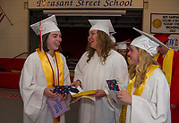 "Renee Corriveau, Riley Grant and Rebecca Bladecki read over letters from current students at Pleasant Street School after they ""walked the halls"" on Thursday afternoon as graduating seniors.  (Karen Bobotas/for the Laconia Daily Sun)"