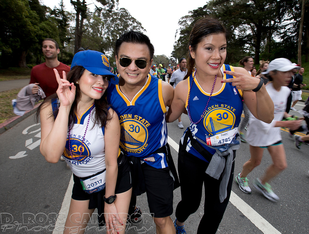 No Splash Brothers here, but Setts Estaniel, from left, Hil Asilo and Marilen Bernardo, all of South San Francisco, Calif., do their best impersonation of the Golden State Warriors during the 104th running of the Bay to Breakers 12k, Sunday, May 17, 2015 in San Francisco. Tens of thousands of runners, some clad in costume and some in nothing at all, populated the 7.42-mile route. (D. Ross Cameron/Bay Area News Group)