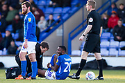 Macclesfield Town midfielder Emmanuel Osadebe assisted by the physio during the EFL Sky Bet League 2 match between Macclesfield Town and Bradford City at Moss Rose, Macclesfield, United Kingdom on 30 November 2019.