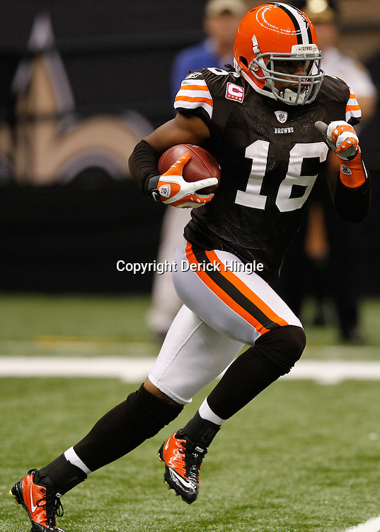 Oct 24, 2010; New Orleans, LA, USA; Cleveland Browns wide receiver Josh Cribbs (16) runs back a kick during the first half of a game against the New Orleans Saints at the Louisiana Superdome. Mandatory Credit: Derick E. Hingle