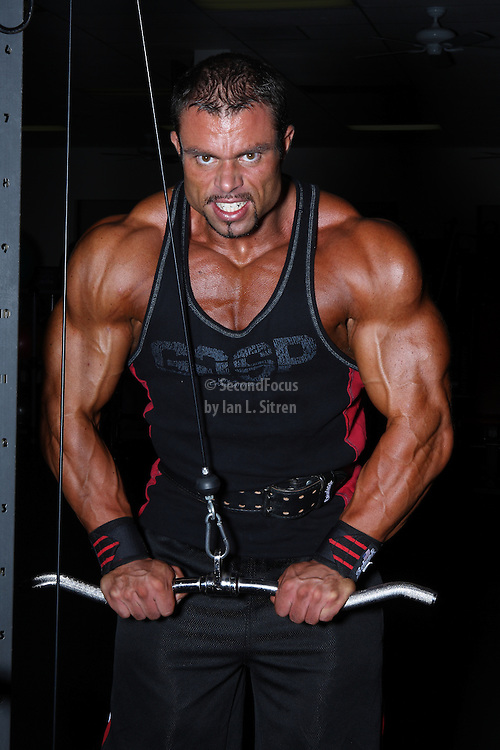 IFBB Pro Bodybuilder Daniel Hill doing cable trip push downs.