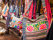 16 JULY 2014 - SAMUT PRAKAN, SAMUT PRAKAN, THAILAND: Souvenir purses and bags done in traditional Thai styles for sale in Ancient Siam. Ancient Siam is a historic park about 200 acres (81 hectares) in size in the city of Samut Prakan, province of Samut Prakan, about 90 minutes from Bangkok. It features historic recreations of important Thai landmarks and is shaped roughly like the country of Thailand.      PHOTO BY JACK KURTZ