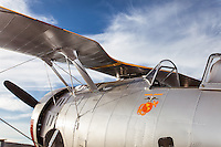 Grumman F3F vintage airplane, view of cockpit and top wing parked under a blue sky in Sonoma, CA. (Property Released)