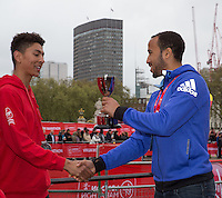Tottenham and England star Andros Townsend presents trophies to the category winners of the Virgin Giving Mini London Marathon, Sunday 26th April 2015. <br /> <br /> Neil Turner for Virgin Money London Marathon<br /> <br /> For more information please contact Penny Dain at pennyd@london-marathon.co.uk