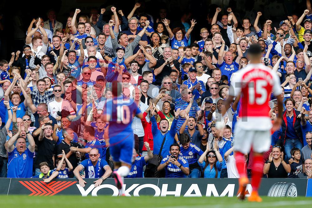 Chelsea fans celebrate after Eden Hazard (pictured) scores a goal to make it 2-0 - Mandatory byline: Rogan Thomson/JMP - 07966 386802 - 19/09/2015 - FOOTBALL - Stamford Bridge Stadium - London, England - Chelsea v Arsenal - Barclays Premier League.
