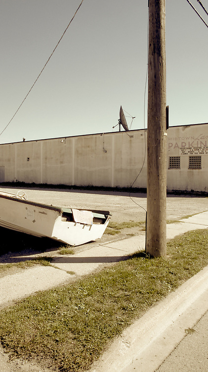 """Free Boat"" sign on speedboat on side of street in Port Colborne, Ontario, Canada"