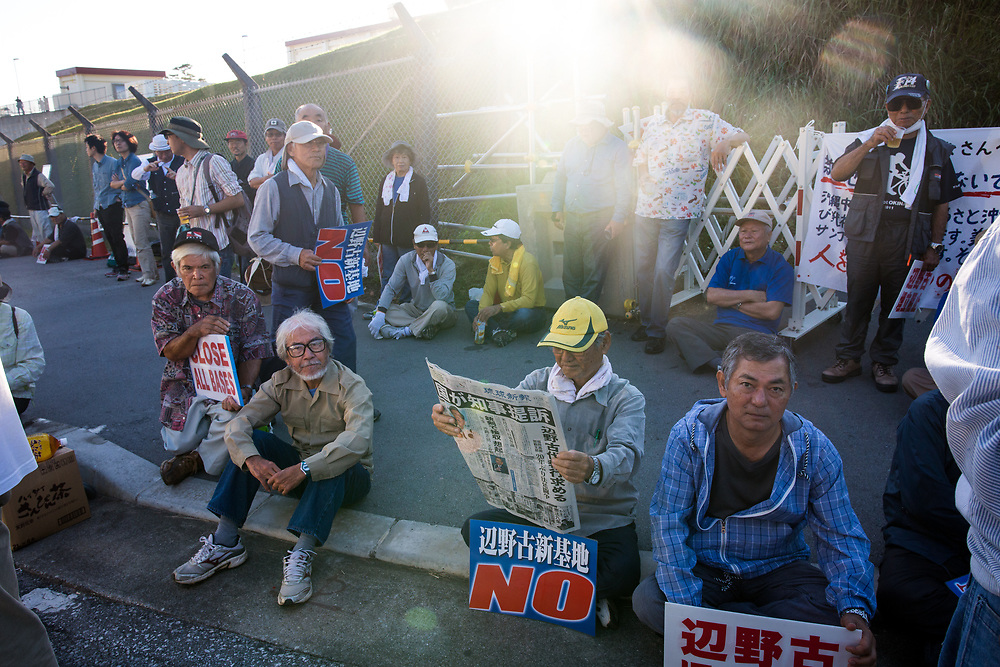 OKINAWA, JAPAN - NOVEMBER 18:  Anti U.S. Base protesters are seen with their placards in front of the gate of U.S Base in Camp Schwab during a protest against the construction of the new U.S base in Henoko, Nago, Okinawa prefecture, Japan on November 18, 2015. (Photo: Richard Atrero de Guzman)