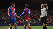 Scott Dann and Yohan Cabaye disagree with Mike Dean's decision during the Barclays Premier League match between Crystal Palace and Southampton at Selhurst Park, London, England on 12 December 2015. Photo by Michael Hulf.