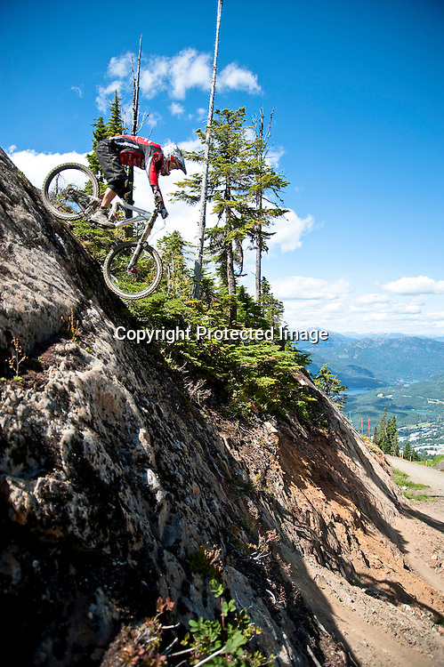 Pete Stace-Smith rides down a steep granite face on the trails of Whistler Mountain BIke Park.