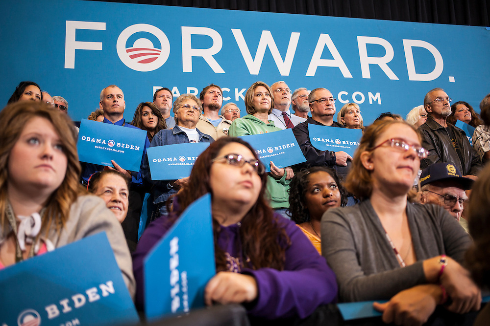Audience members listen as Vice President Joe Biden speaks at a campaign rally while on a two-day swing through Iowa on Tuesday, September 18, 2012 in Ottumwa, IA.