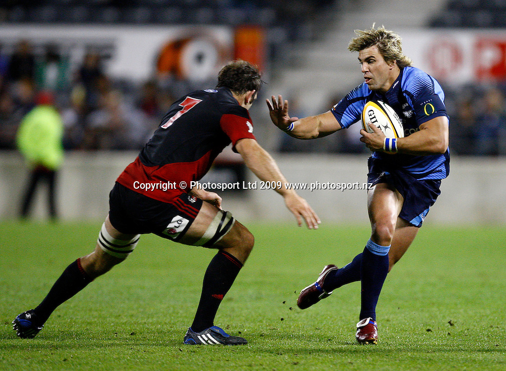 Wynard Olivier puts out the fend to George Whitelock during the Super 14 rugby union match, Canterbury Crusaders v Vodacom Bulls, AMI Stadium, Christchurch. 3 April 2009. Photo: William Booth/PHOTOSPORT