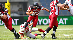 13.07.2011, UPC Arena, Graz, AUT, American Football WM 2011, Group B, Japan (JAP) vs Canada (CAN), im Bild Matt Walters (Canada, #33, RB) braks through the middle after a failed tackle attempt from Shoichiro Suzuki (Japan, #45, LB)  // during the American Football World Championship 2011 Group B game, Japan vs Canada, at UPC Arena, Graz, 2011-07-13, EXPA Pictures © 2011, PhotoCredit: EXPA/ T. Haumer