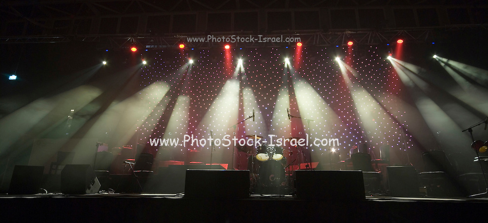 Coloured stage lights and smoke as a vivid colour background.