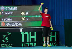 Blaz Kavcic of Slovenia (green) plays against Joao Sousa  of Portugal (red) during 4th match of Davis cup Slovenia vs. Portugal on February 2, 2014 in Kranj, Slovenia. Photo by Vid Ponikvar / Sportida