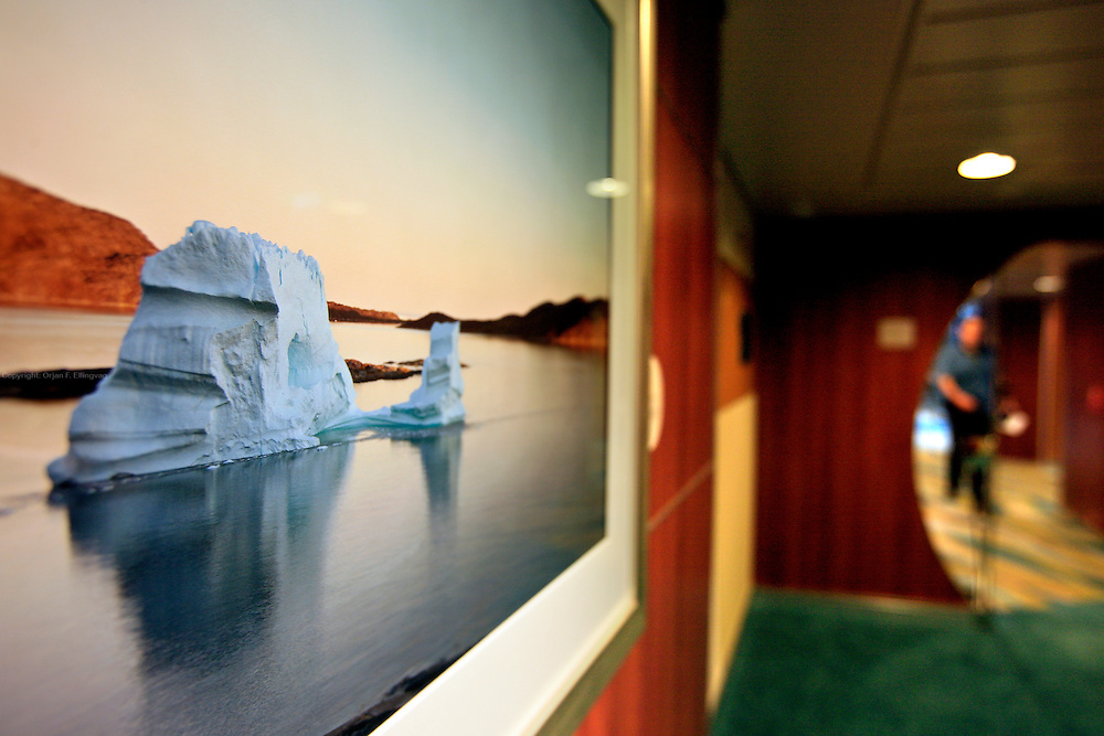 A photography of an iceberg is one of the art pieces  onboard the cruise ship Oasis of the Seas. The ship, currently the largest in the world, is owned by Royal Carribean Cruise Line.
