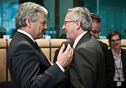 Jean-Claude Juncker, Luxembourg's prime minister, and president of the Eurogroup, right, speaks with Didier Reynders, Belgium's finance minister, during the meeting of European Union finance ministers in Brussels, Belgium, on Monday, May 17, 2010. (Photo © Jock Fistick)