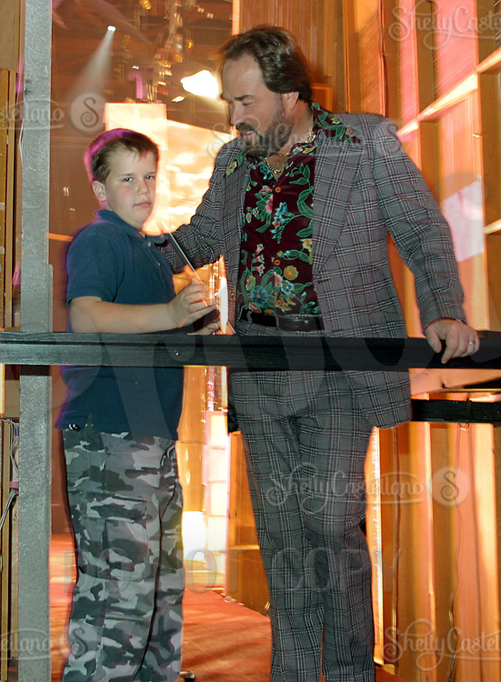 Jan 05, 2003; Burbank, CA, USA; Gameshow Host RICHARD KARN gets a Happy Birthday card from his 10 year old son Cooper back stage during taping of the Village People vs. Disco Divas Family Feud at NBC Studios. Each team played on behalf of their favorite charity for a show to be aired in Feburary 2003.<br />