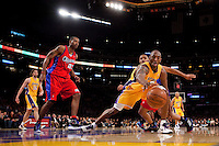15 January 2010: Guard Kobe Bryant of the Los Angeles Lakers reaches for a loose ball against the Los Angeles Clippers during the second half of the Lakers 126-86 victory over the Clippers at the STAPLES Center in Los Angeles, CA.