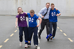No Repro Fee: 10/04/13.Better Stick to the Rugby Ian....Leinster star Ian Madigan surprises school kids for GOAL...Pictured here are Leinster out-half Ian Madigan and GOAL CEO Barry Andrews wih Isobel McCann (left), age 11 and Conor O'Neill, age 12 .The boys and girls of Kill O' The Grange primary school in Deansgrange got a big surprise when Leinster and Ireland rugby star, Ian Madigan paid them a surprise visit to launch a new annual fundraiser for GOAL on 10/04/13. Madigan was helping the aid agency promote their 'GOAL Sports Challenge', a multi-sport event that hopes to boost fitness levels amongst children and teenagers, and also raise money and awareness for some of GOAL's programmes for vulnerable children throughout the developing world..For schools interested in signing up, please email schools@goal.ie for further information about GOAL's work go to www.goal.ie , www.facebook.com/goalireland , @GOALIreland ..Pic: Andres Poveda