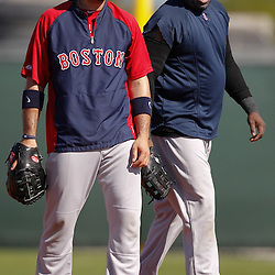 February 19, 2011; Fort Myers, FL, USA; Boston Red Sox first baseman Adrian Gonzalez (left) and first baseman David Ortiz during spring training at the Player Development Complex.  Mandatory Credit: Derick E. Hingle