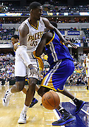 Feb. 28, 2012; Indianapolis, IN, USA; Indiana Pacers center Roy Hibbert (55) dribble the ball around Golden State Warriors power forward Ekpe Udoh (20) at Bankers Life Fieldhouse. Indiana defeated Golden State 102-78. Mandatory credit: Michael Hickey-US PRESSWIRE