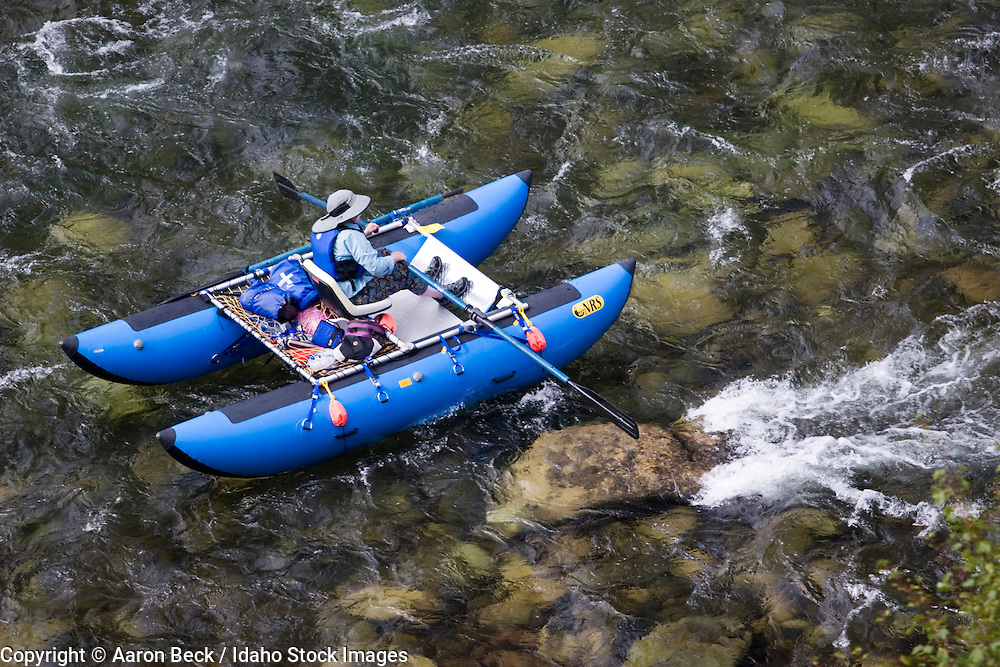 North America, Idaho, Middle Fork Salmon River, Frank Church Wilderness, a cataraft floats over shallow water near the Middle Fork Lodge and the Thomas Creek airstrip.